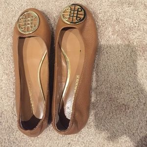 Selling brown flats with gold design buckle